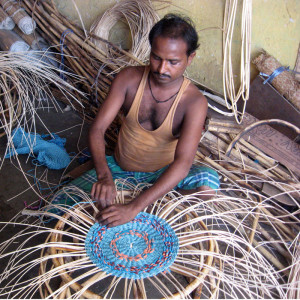 Weaver busy weaving a Retyrment Plan stool 800x800